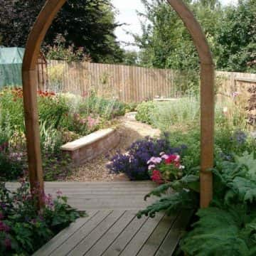 Garden Design With Coloured Flowers & Archway